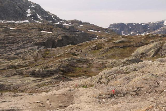 Trolltunga_349_06232019 - In the final kilometer or so of the Trolltunga Trail where I had to negotiate the granite plateau that required the aid of these red Ts and rock cairns to stay on track