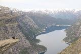 Trolltunga_376_06232019 - Photo of a couple of people sitting on the Trolltunga
