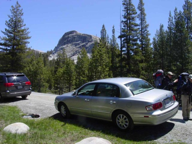 Tuolumne_Meadows_001_05292004 - People parked along the road shoulder in front of Lembert Dome to leave the car behind and hike into the Yosemite backcountry