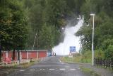 Turtagro-Ovre_Ardal_mtn_rd_046_07212019 - Just before the toll road leading up out of Øvre Årdal, I noticed this gushing waterfall spilling right into town, but due to the bad weather, it was hard to take a not-so-blurry photo due to the wet windshield