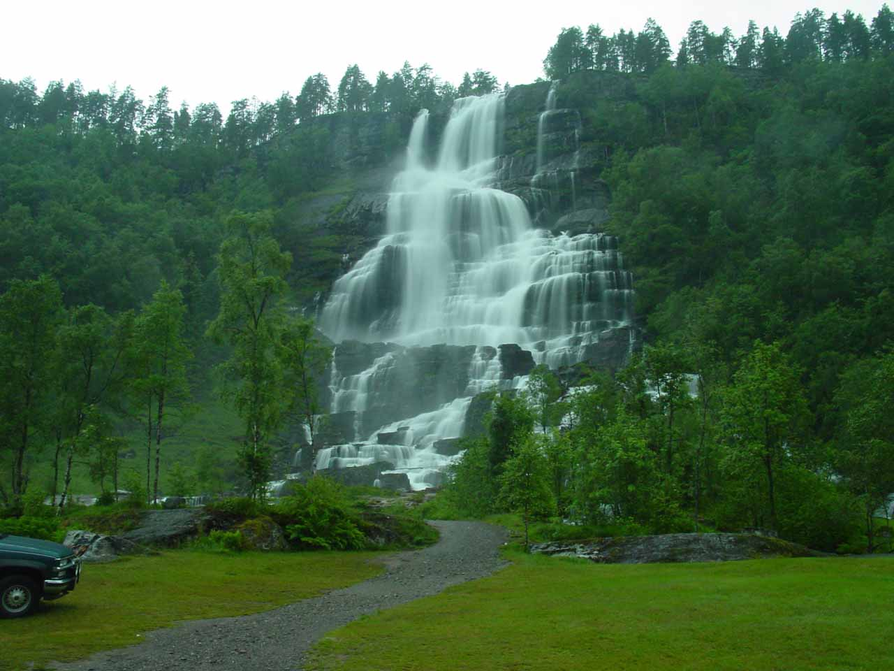 Full context of Tvindefossen with someone else's car parked