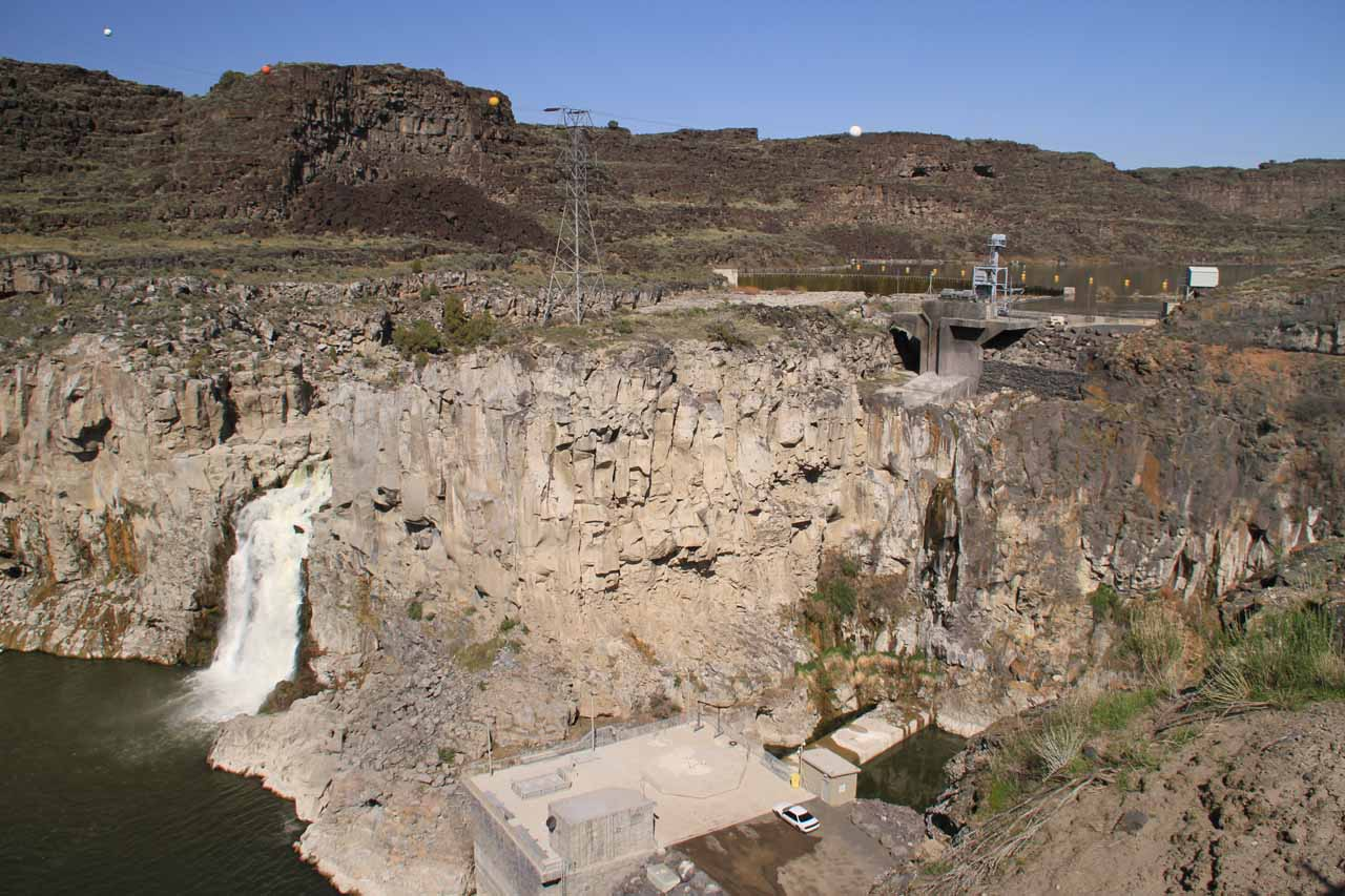 Contextual look at Twin Falls with the former location of the other waterfall, which is now a bare streaked wall