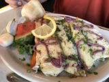 Two_Sisters_Cafe_002_iPhone_08062017 - Huckleberry sauce drizzled over rainbow trout dish served up at the Two Sisters Cafe