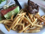 Two_Sisters_Cafe_003_iPhone_08062017 - This was Tahia's portion where we gave her some of our steak and fries as well as a watermelon at the Two Sisters Cafe
