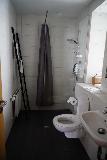 Tyr_Apts_003_08182021 - The bathroom inside our unit at the Tyr Apartments