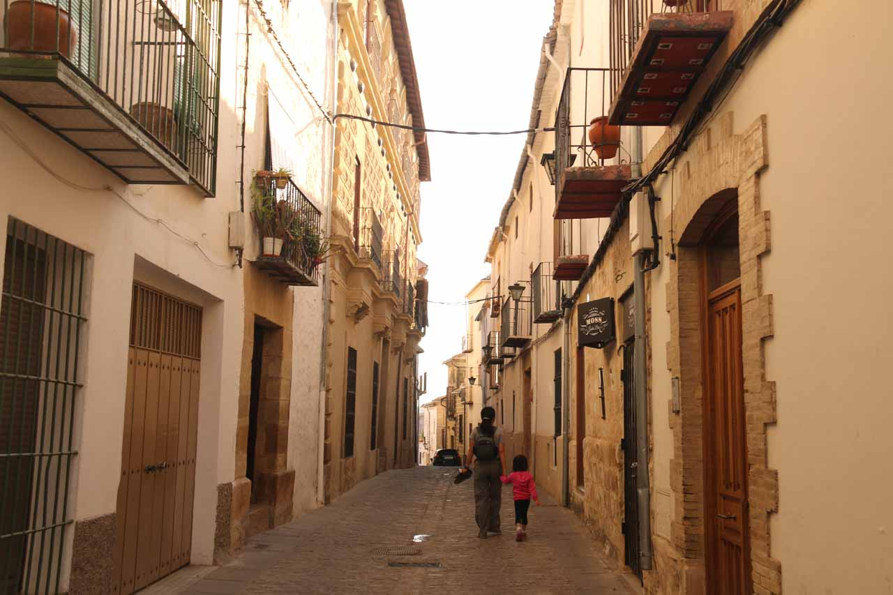 Julie and Tahia walking a narrow alleyway that we'd ultimately have to drive to get out of Ubeda