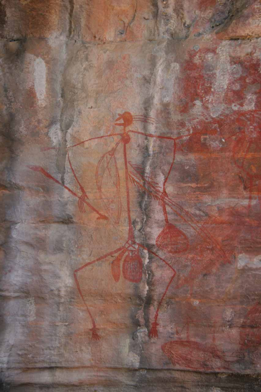 Some kind of stick figure man painted on the rock