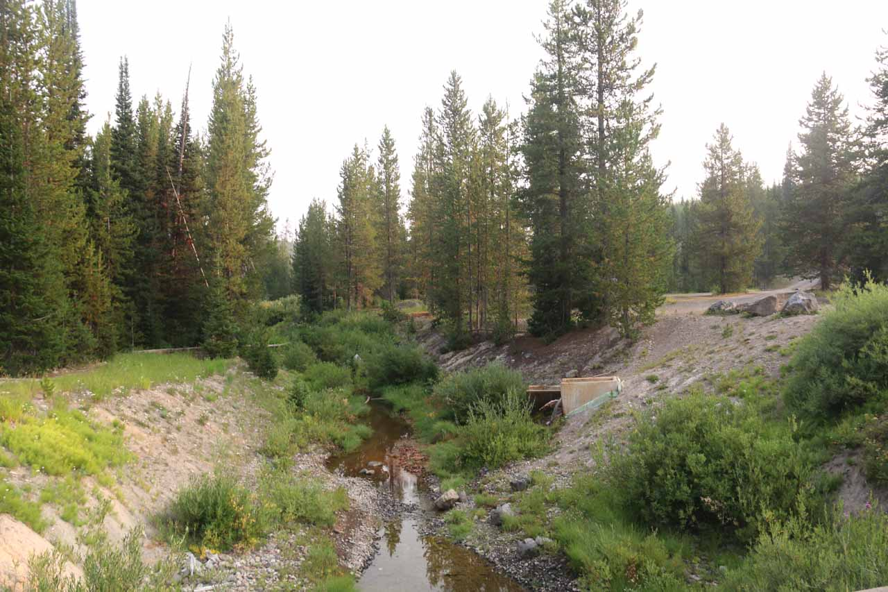 Crossing over the spillway creek beneath the Grassy Lake Dam