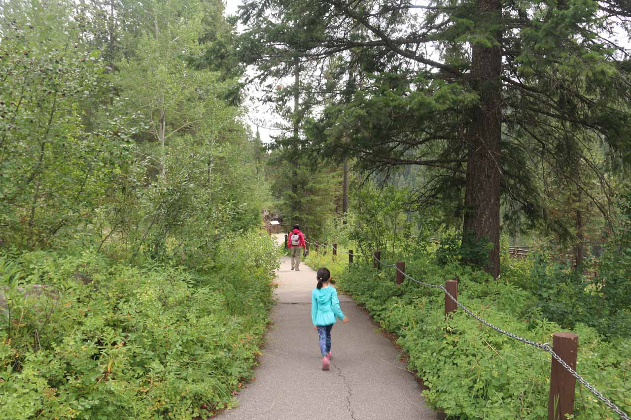 Julie and Tahia following along a wheelchair-accessible path as we approached the Upper Mesa Falls