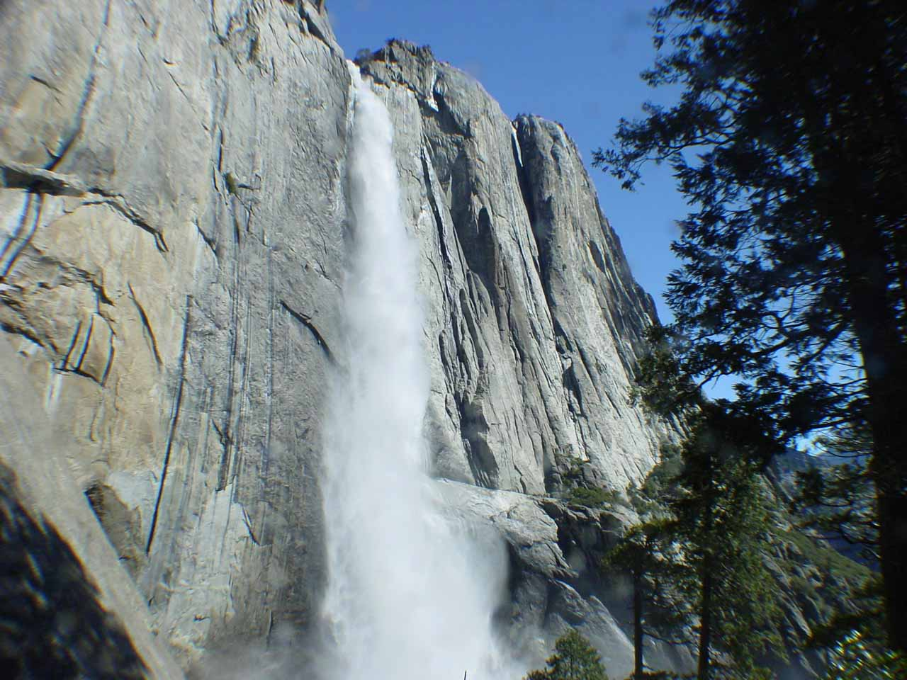 Angled view of Yosemite Falls with some of its mist getting to the granite steps we were on