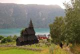 Urnes_stavkirke_067_07202019 - Contextual look at the scenic Urnes Stave Church and Lustrafjorden in the distance
