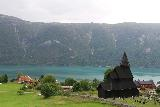 Urnes_stavkirke_069_07202019 - Contextual look at Lustrafjorden fronted by a hamlet and the Urnes Stave Church