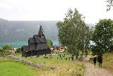 Urnes_stavkirke_112_07202019 - Context of Julie and Tahia walking back towards the Urnes Stave Church after attempting to find the utsikt
