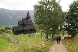 Urnes_stavkirke_114_07202019 - Another look at Julie and Tahia walking towards the Urnes Stave Church from the trail to some utsikt