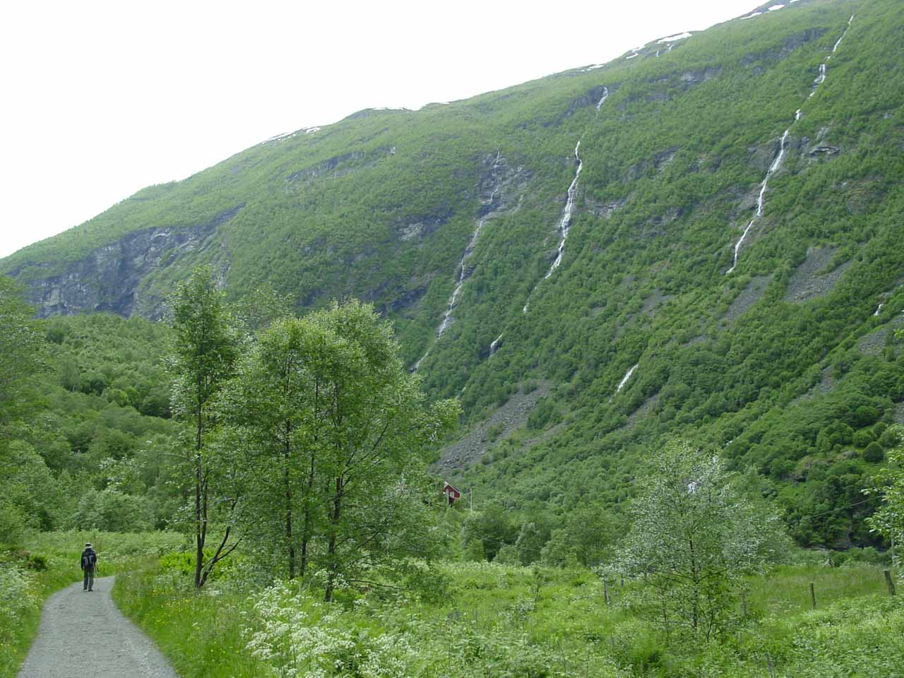 Julie passing before the four stringy waterfalls near Vetti