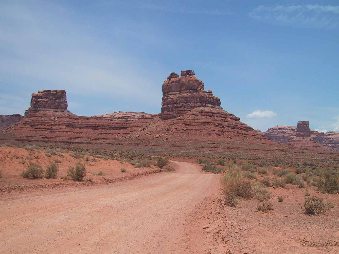 The unpaved road passing through more buttes and mesas in Valley of the Gods
