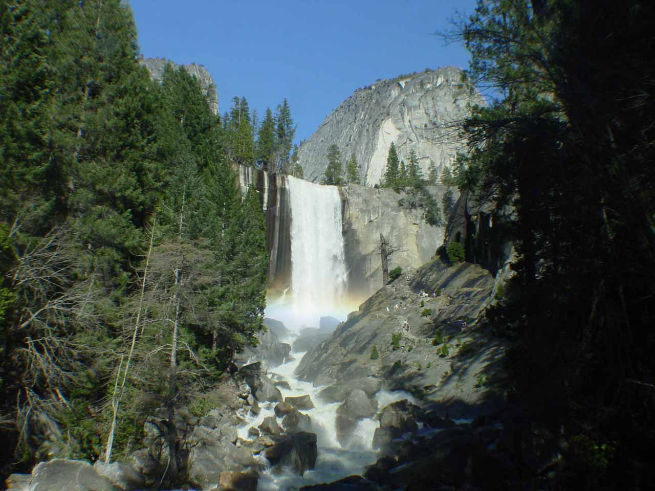 Looking up towards Vernal Fall with rainbow at its base