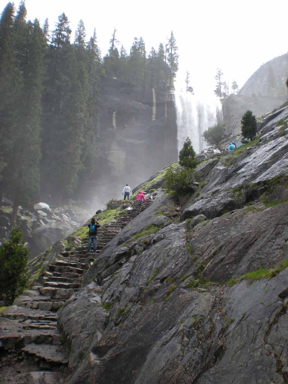 Going up some wet granite steps into the misty part of the Mist Trail
