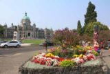 Victoria_BC_357_08032017 - Some totem pole and bed of flowers fronting the Parliament Building by the Victoria Harbour