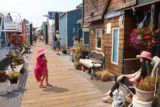 Victoria_BC_478_08032017 - Tahia checking out a mannequin sitting in front of one of the houseboats at Fisherman's Wharf in Victoria