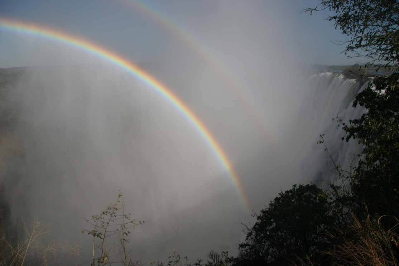 Double rainbow at Victoria Falls' misty mess as seen from the Zambia side