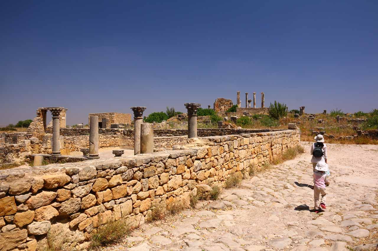 Julie and Tahia walking amongst the Roman ruins of Volubilis