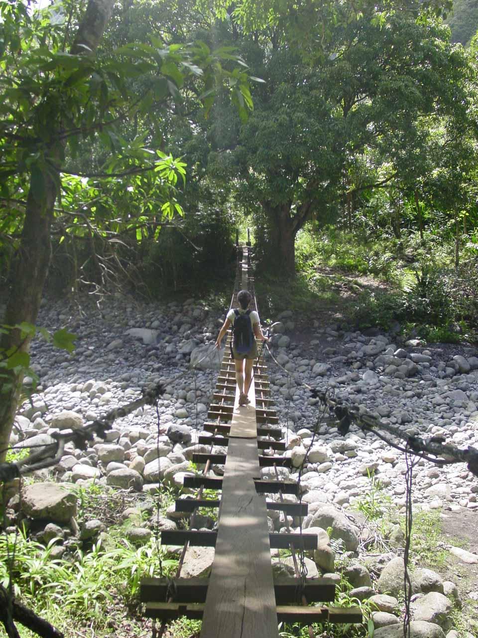 Julie crossing that first swinging bridge