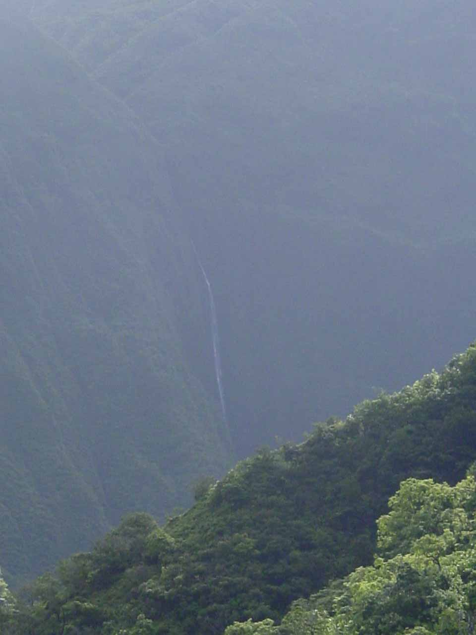 View of Mana-nole Falls from deep in the Waihe'e Valley Trail