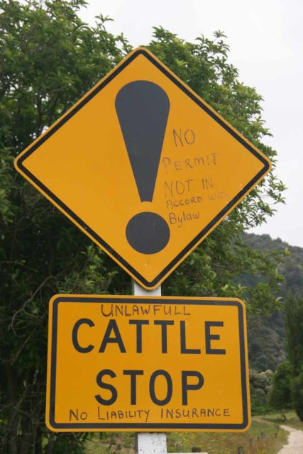 Wainui_Falls_074_01012010 - Contentious graffiti on the signs by the cattle guard near the start of the hike to Wainui Falls
