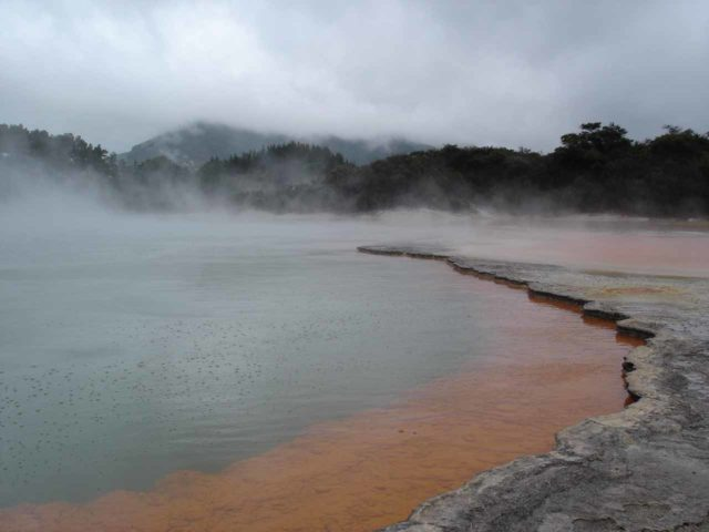 Waiotapu_005_jx_11132004 - Another one of the impressive sights of Wai-o-tapu was the colorful Champagne Pool shown here (colorful even despite the rainy conditions)