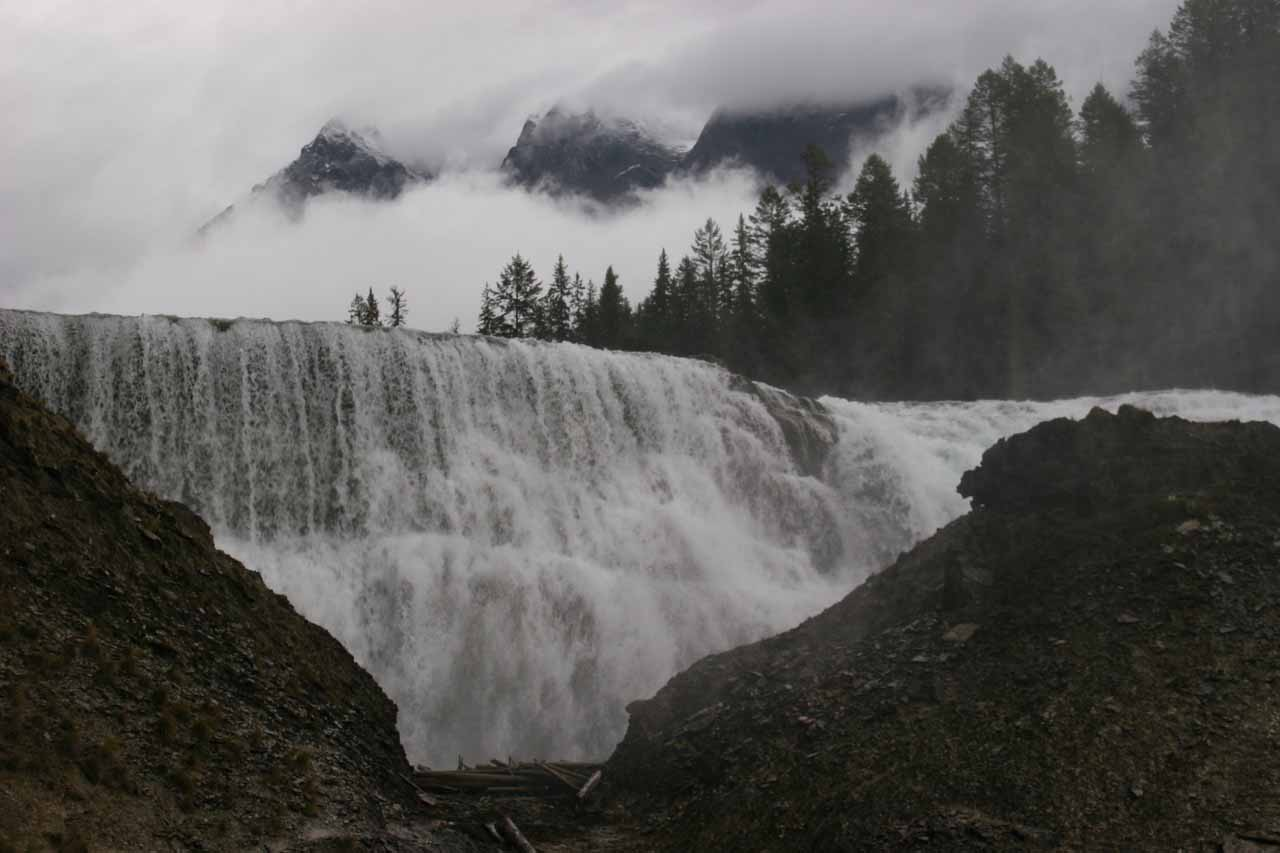Looking right at the front of Wapta Falls with some peaks momentarily revealing themselves amidst the cloud cover