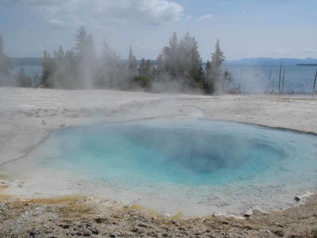 West_Thumb_Geyser_Basin_038_jx_06222004 - A blue hot spring fronting Yellowstone Lake.  This was in the West Thumb Geyser Basin, which was not far north of Lewis Falls