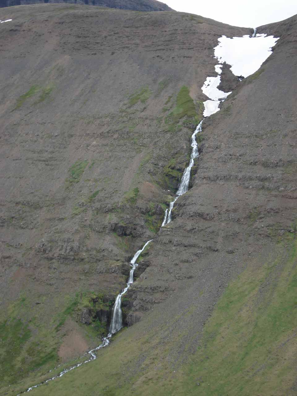 When we left the tunnel, we noticed this tall cascade spilling into Tungudalur