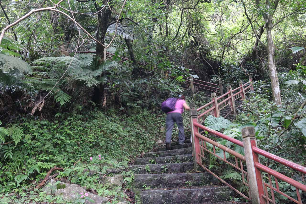 Mom continuing to climb up the trail to the uppermost of the Wufengchi Waterfalls