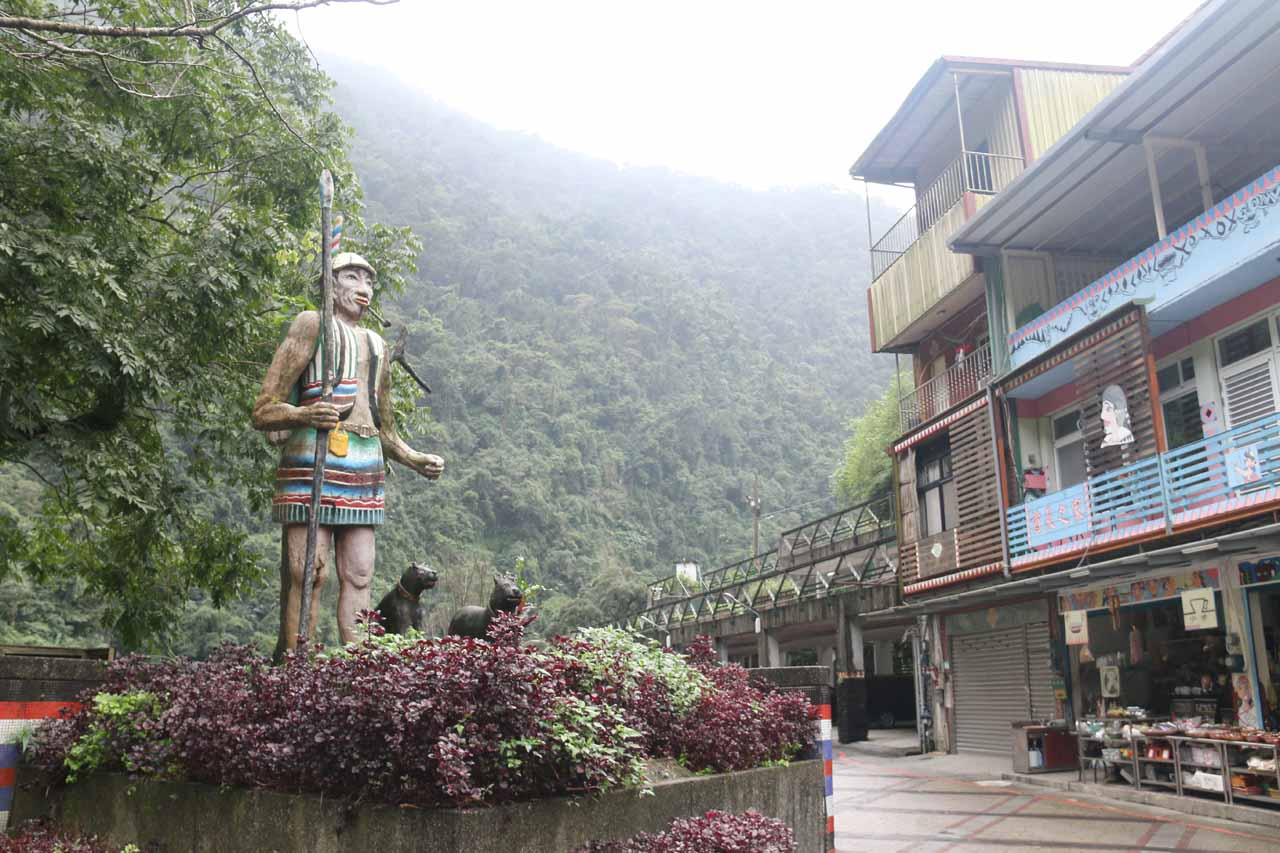 In front of the main drop of the Wulai Waterfall was a walking plaza with this Atayal statue