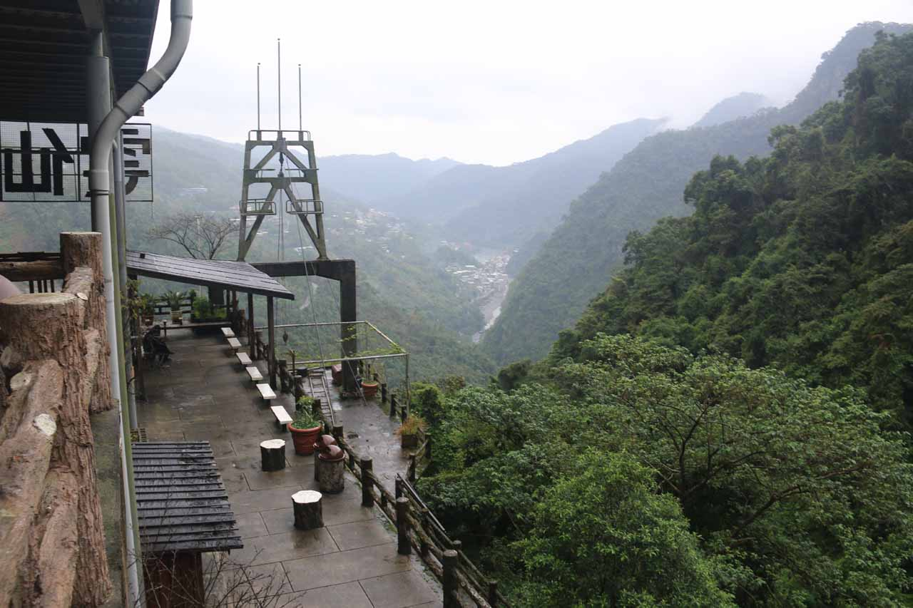 Context of the upper cable car station and the Wulai Valley in the distance