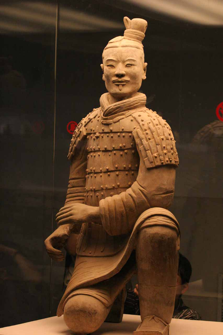 A kneeling archer