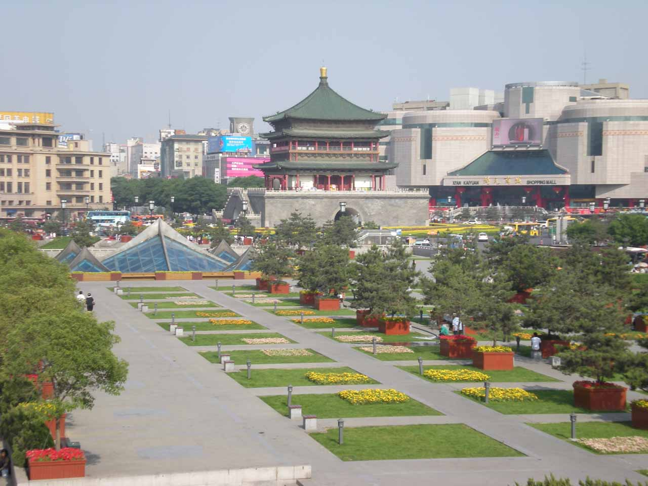 Looking down one of the streets towards another tower and some gardens lined before it in Xi'an
