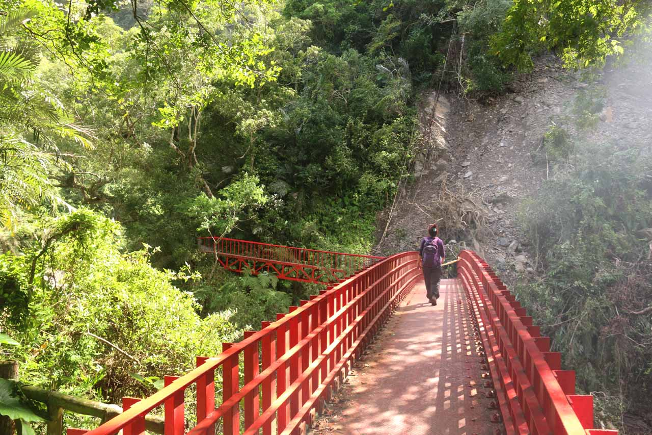 Crossing the bridge over the Yunei Stream with a landslide affecting part of the bridge