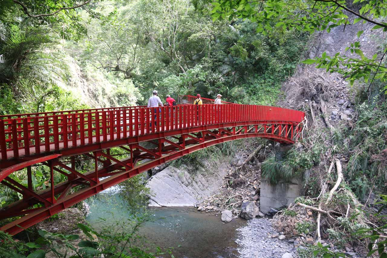 Some other folks crossing the bridge on the way to the base of the Xiao Wulai Waterfall