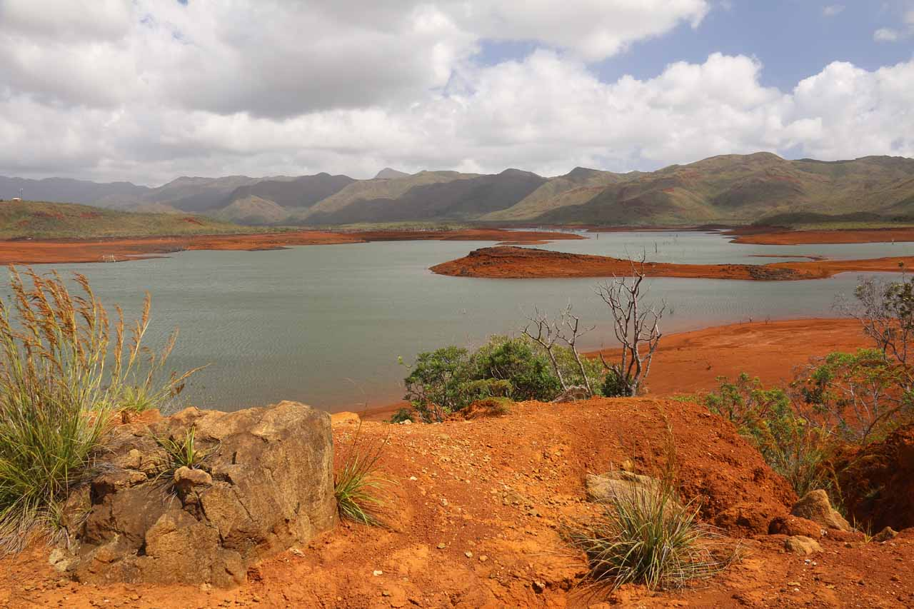Part of the Lac de Yate. Note the striking contrast of the red dirt surrounding the man-made lake