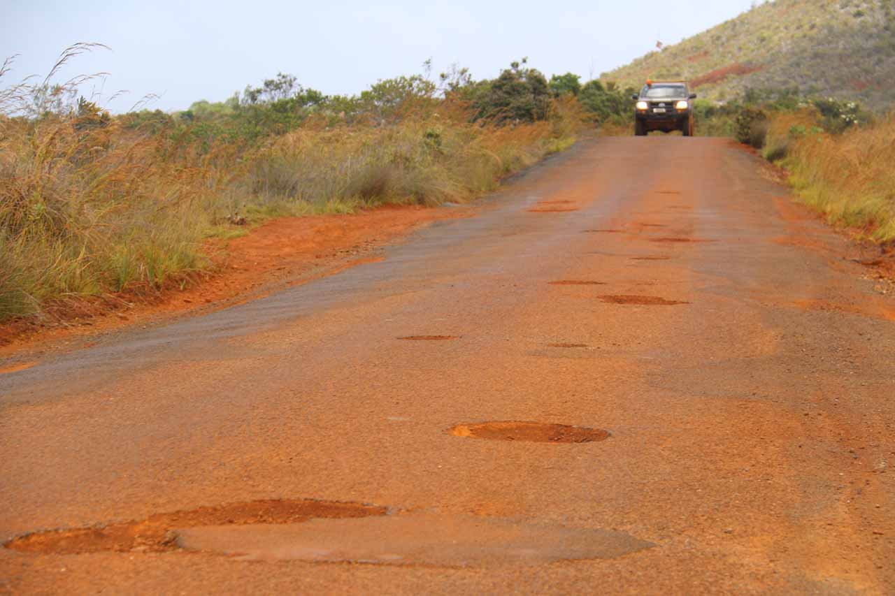 Finally, the road became full of potholes as the unpaved parts became paved. It almost made me wish the road stayed unpaved