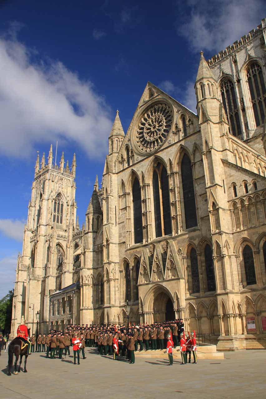 A military procession about to get set up on one side of the York Minster
