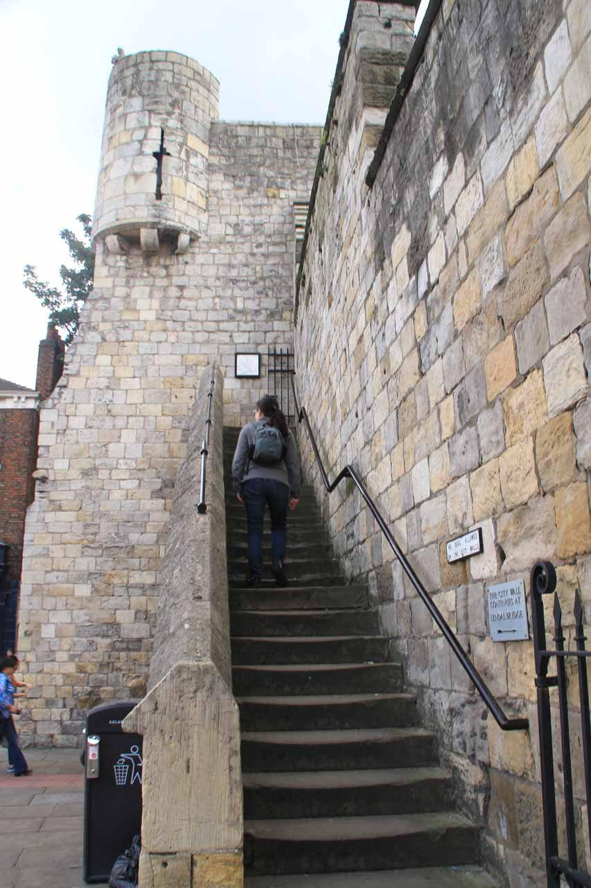 Julie making her way up to the ramparts at Bootham Bar