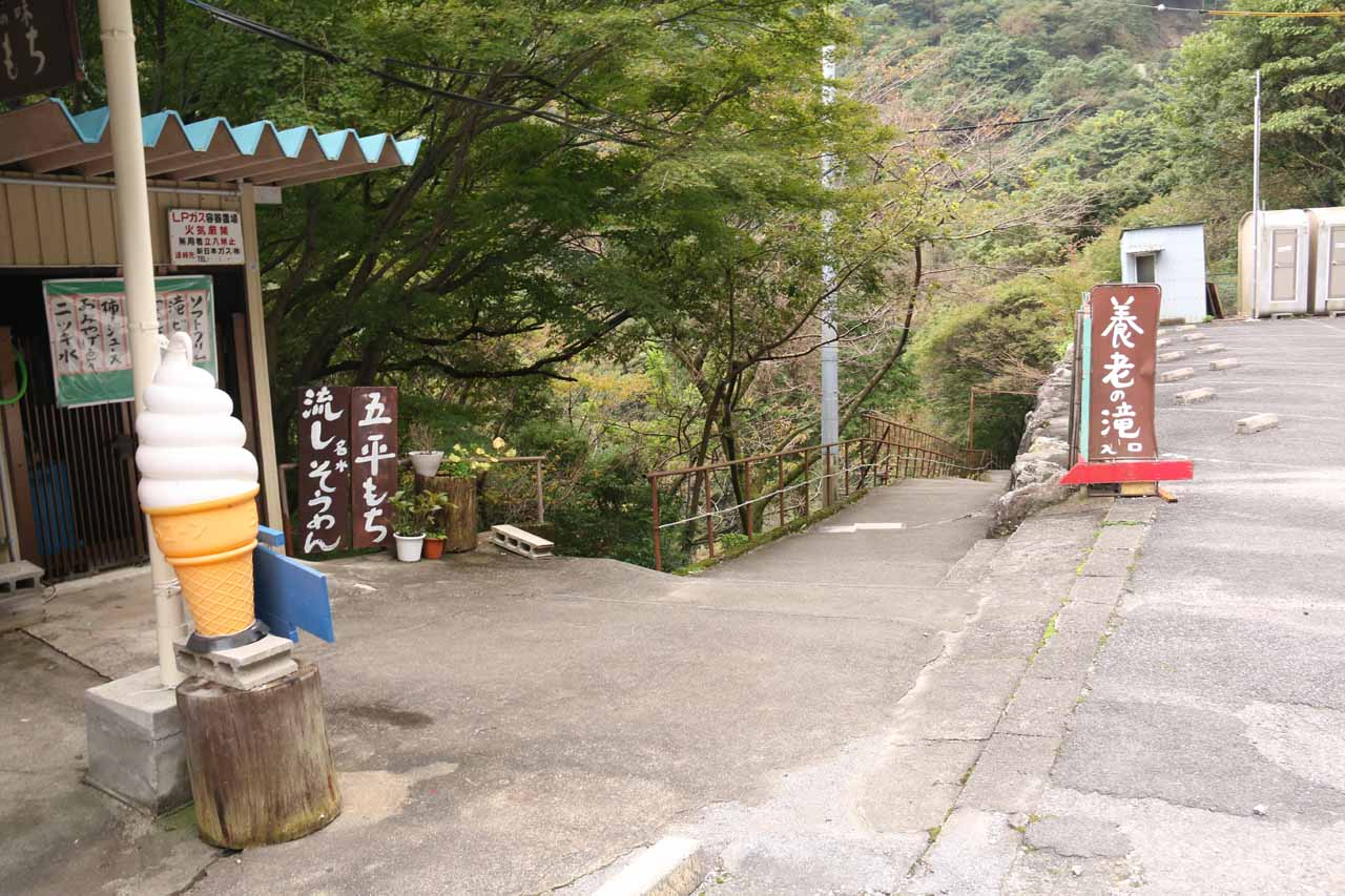 The ramp descending beneath the car park (to the right of the ice cream cone sign) was the walkway leading to the Yoro Waterfall