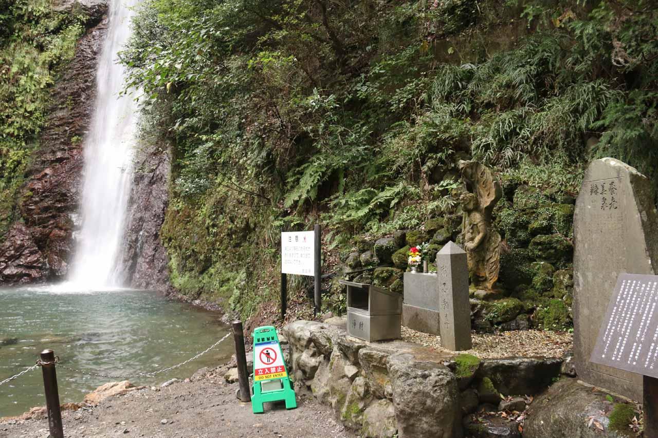 A small shrine or memorial adjacent to the Yoro Falls