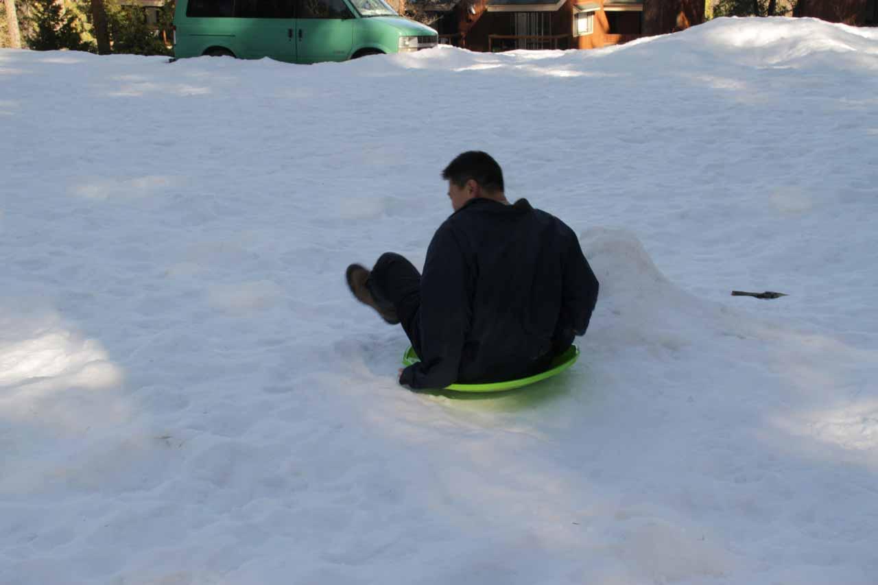 Me sliding on the plastic sled
