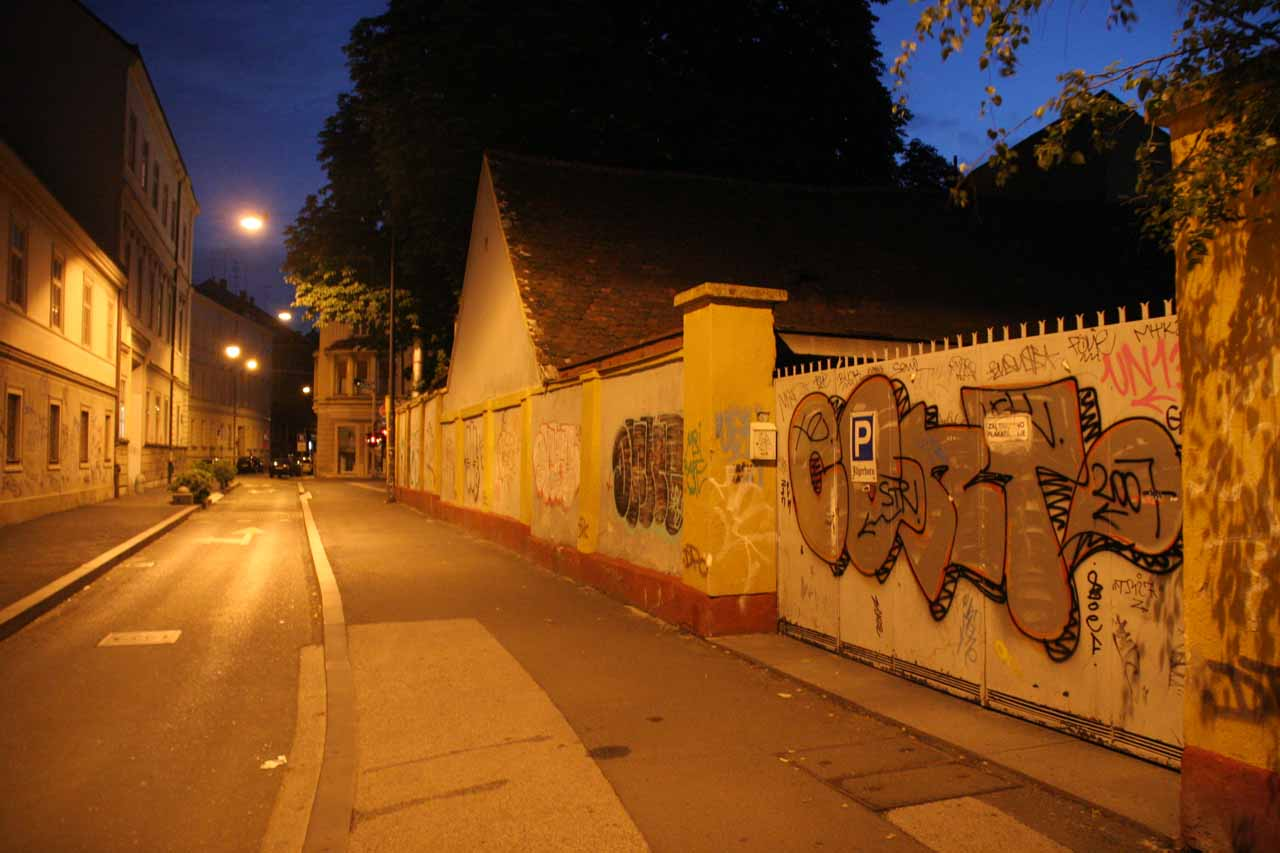 The graffiti-covered gate to the car park for the hotel