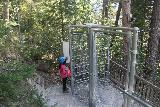 Zammer_Lochputz_172_07202018 - Tahia about to go through the turnstile to leave the Zammer Lochputz excursion