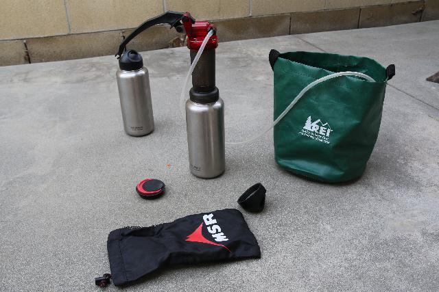 This is my backpacking water filtration system (my trusty MSR MiniWorks EX) pumping from a collapsible bucket and feeding filtered water into a stainless steel bottle with a wide mouth that happens to mate with the filter. This is what I'd use if size and weight are major considerations